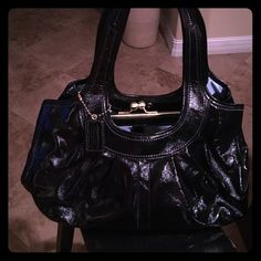 COACH Never Been Used** Black Coach purse with baby blue inside, 3 large sectioned off sides of the bag. Very clean inside. Beautiful patten leather! Coach Bags Shoulder Bags