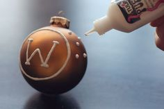 DIY Monogram Ornament - Puffy paint is all you need to transform a plain ornament for Christmas.