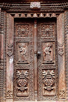 Picture of hindu temple wooden carved door, bhaktapur, Nepal stock photo, images and stock photography. Cool Doors, Unique Doors, Indian Architecture, Architecture Photo, Religious Architecture, Wooden Door Hangers, Wooden Doors, Nepal, Main Door Design
