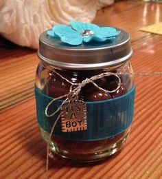 """Baby food jar party favors - Spray-painted lid, added a flower, a ribbon around the jar, and an """"it's a boy charm"""", and filled with Costco's chocolate covered almonds (photo only)"""