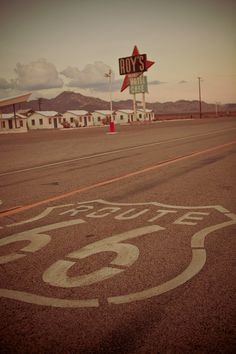 Route 66 Roy's Motel Cafe  Vintage Neon Sign by RetroRoadsidePhoto