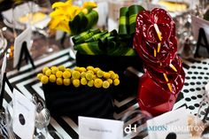 unique textural centerpiece in yellow, green, and red - Damion Hamilton