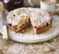 Raspberry Bakewell cake - could substitute ground almost with flour and add almond essence. Use oats on top instead of flakes almonds.