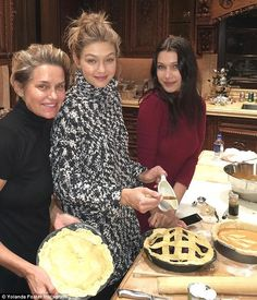 Domestic goddesses: Gigi's mother Yolanda Foster joined her daughters Gigi and Bella for a photo as the ladies put finishing touches to their pies