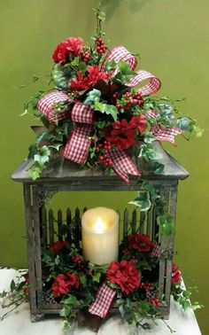 Summer time design of red geraniums, ivy and berries on a rustic lantern. Designed by Tim @ Twigs. time design of red geraniums, ivy and berries on a rustic lantern. Designed by Tim @ Twigs. Christmas Arrangements, Christmas Centerpieces, Xmas Decorations, Floral Arrangements, Christmas Lanterns, Christmas Wreaths, Christmas Ornaments, Rustic Christmas, Rustic Lanterns