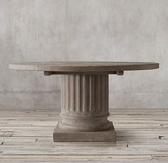 RH's Salvaged Wood Architectural Column Round Dining Table:The massive, hand-carved columns and thick, planked tops of our tables are built from reclaimed pine, salvaged from 100-year-old buildings in Great Britain.