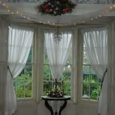 With some creativity, bay window treatments can help solve a challenging window arrangement dilemma. Bay windows are often found in breakfast nooks and . Window Curtain Designs, Window Design, Bay Window Curtains Living Room, Country Window Treatments, Lobby Interior, Rustic Curtains, Home Upgrades, Fireplace Design, French Country Decorating