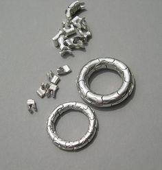 Yael Friedman puzzle rings - http://www.yayo-design.com/puzzles_lb