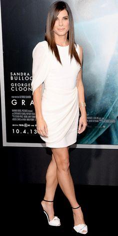 #SandraBullock rocked a white draped #GiambattistaValli dress.@ The Gravity Premiere