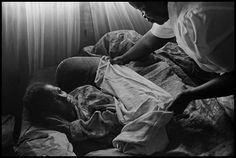 South Africa, 2000 - Care giver comforted an AIDS sufferer. (by James Nachtwey)