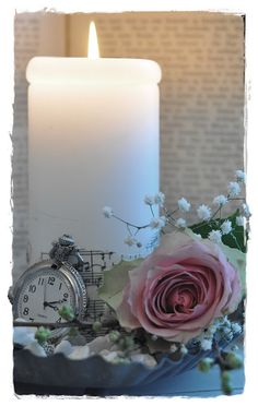 love this simplicity of a single rose w/baby's breath and candle and pocket watch.