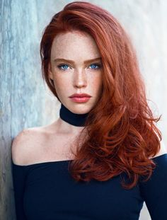 Beautiful model with blue eyes and red hair.Love the contrast on this picture.