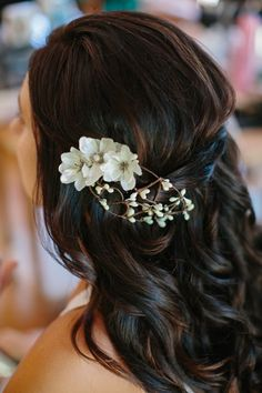 wedding hair down with a simple flower for that added touch.