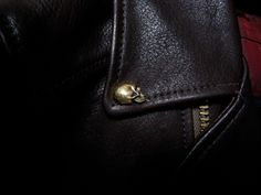 skull button on leather jacket by kureha