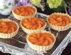 Apricot slices arranged in a spiral make a pretty presentation in Apricot-Almond Tarts.