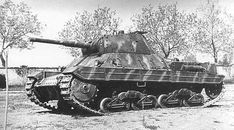 An Italian P26/40 heavy tank with a great example of the applied style  camouflaged paint scheme. Only 108 of these tanks were built