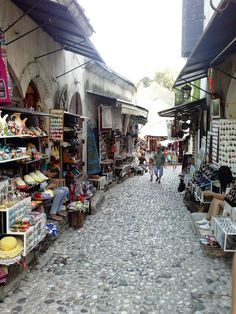 Photo of the souvenirs, handcrafts and shops on the streets of Old Town in Mostar. #mostar #TGM #TourGuideMostar #souvenirs #europe #handcrafts #architecture #paintings #citylife #tradition #herzegovina #luxurytravel
