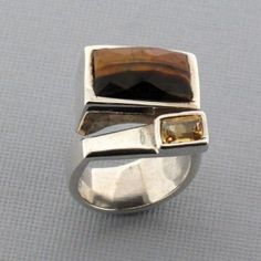 http://purpleleopardboutique.com/1866-4574-thickbox/tigers-eye-and-citrine-sterling-silver-ring.jpg  Tigers Eye Citring sterling silver ring.
