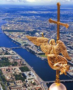 RUSSIA. ST PETERSBURG  The Cathedral of SS Peter and Paul  The needle on the spire of the Peter and Paul Cathedral, built by Dutchman German von Bolis, is topped off by the figure of a flying angel bearing a cross.