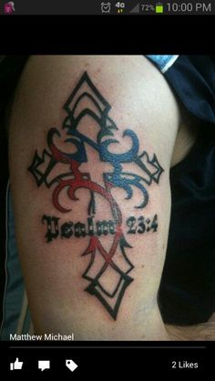 Male cross tattoo