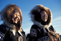 Nunavut_two_Inuit_woman_close_up_in_full_dress_on_cold_day_against_blue_sky_722770.jpg 561×374 pixels