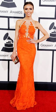 Grammys 2014: E! News host Guiliana Rancic looked chic in a bright orange, laced Alex Perry gown. Marina B jewels complemented her outfit. Originally designed for Sandra Bullock.