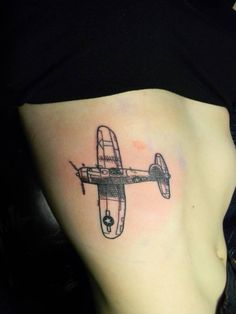 Little side tattoo of an airplane by Craigy Lee. Tattoo artist:...