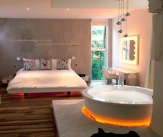 This is a platform bed I want to lounge in.     (Best affordable beach resorts: Be Playa)