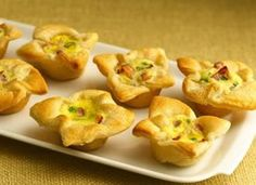 Crescent Bacon-Cheese Tartlets-- Made these tonight! soo good  1 can (8 oz) Pillsbury® refrigerated crescent dinner rolls or 1 can (8 oz) Pillsbury® Crescent Recipe Creations® refrigerated seamless dough sheet 1/3 cup shredded Swiss cheese 1/4 cup chopped cooked bacon 1 tablespoon chopped green onion (1 medium) 1 egg 3 tablespoons whipping cream  bake for 15-20 mins at 375