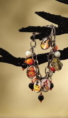 vintage postcards halloween charm bracelet- Just pinned a way to make on of these and this one sells for $20