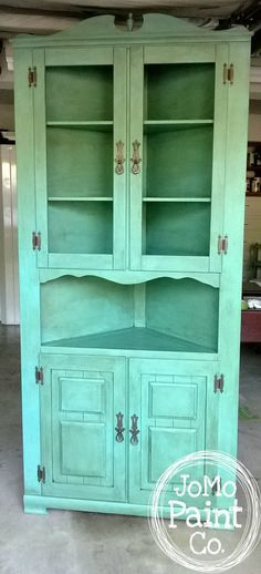 Corner Cabinet painted in an Annie Sloan custom color using Florence, Old White, and Duck Egg Blue and Dark Wax