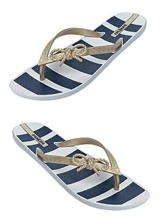 Flexible flip flops with navy and white stripes print footbed and gold thin straps with bow detail. Flip flop is constructed of 100% recyclable material by Ipanema Flip Flops, $25.00