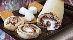 S'mores Pizza Roll-Up - made with refrigerated classic pizza crust and graham cracker crumbs, oats, brown sugar, butter, marshmallow creme and chocolate chips.