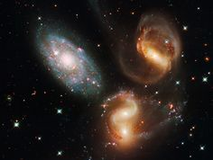 An image taken by the refurbished Hubble Space Telescope shows a clash among members of a famous galaxy quintet reveals an assortment of stars across a wide color range, from young, blue stars to aging, red stars. Image released by NASA on Wednesday, Sept. 9 2009.