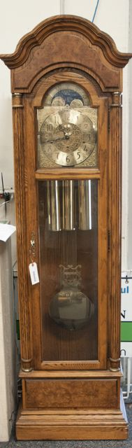 Grandfather clock. For more information visit us @ www.CalAuctions.com