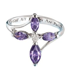 """A sterling silver elegantly designed ring in the shape of a cross made out of purple and clear CZs. Inside of ring is inscribed with the words """" With God All Things Are Possible"""".Sterling Silver is the standard for fine silver jewelry in the world over. Only Sterling Silver can be stamped with a"""