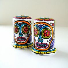 Sugar Skulls Salt and Pepper Shakers Ceramic Hand Painted Day of the Dead Folk Art Tabletop Pink Green Turquoise Yellow. $45.00, via Etsy.