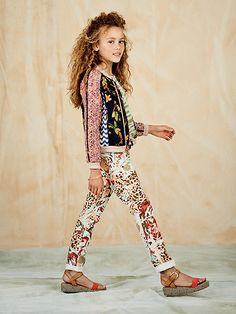 Take the print parade to the next level with this quilted patchwork jacket and allover printed pants. http://webstore-all.scotch-soda.com/girls/rbelle-%2320/ss14-girls-lookbook-20.html