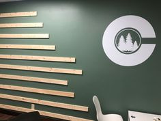 This simple white cut vinyl creates a professional look at the new offices of a local chiropractor. Office Signage, Custom Wall Murals, Home Wallpaper, Sign Design, White Walls, Offices, Brick, Simple