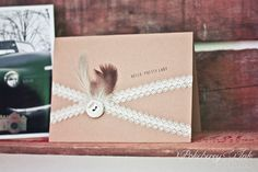 Kraft paper card with lace ribbon, vintage button, & feathers for any occasion. Set of ten for $20 on Etsy by Pokeberry Ink Press