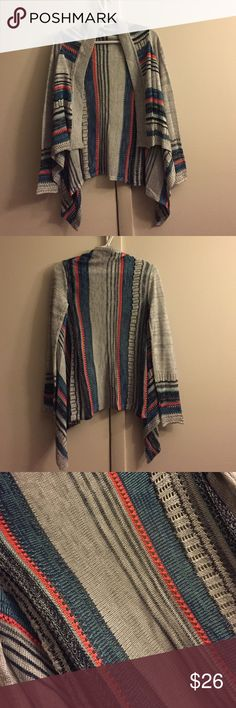 NWOT striped cardigan Brand new, never worn. Size small. Longer in the back than in the front. Colors are silver, navy, teal and orange Eyeshadow Sweaters Cardigans