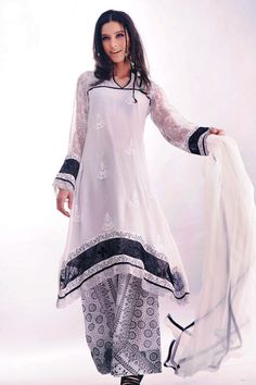 Tradition Dress Collection http://fashiondesignslatest2012.blogspot.com/2013/03/tradition-dress-collection-traditional.html Collectionof modern andtraditional dressKurta's chudiar materials, chudidar and salwar ethnic wear,casual sarees can be sighted