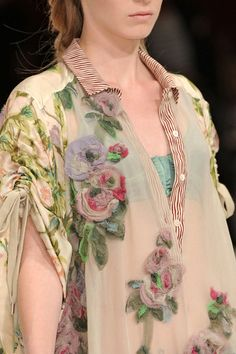 Garment Design Detail - embellishment on the chiffon fabric...like the way the striped tabs shows through...just in general love the mix of patterns and texture