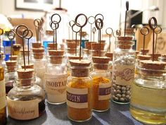 Cute idea for a Steampunk/Victorian themed wedding: VIAL place cards!