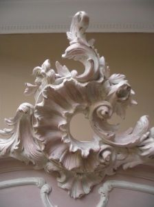 Rococo style centerpieces for armoires, mirrors or bed headboards are very popular today. 'Wild Goose Carvings' is currently developing a beautifully hand carved wooden piece, in a similar style to this. It will be available from stock in early 2015. For more designs, see www.buycarvings.com