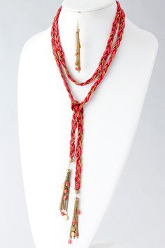 Absolutely unique, a braid of Suede and chain accented with Charm gem covered Tassels. There are many possibilities on how to wear this Necklace Set; you can wear it long, or as we're showing, you can tie it as a belt or make it into a Bracelet.