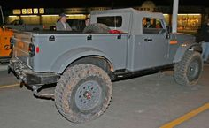 The Nukiser looks to be an update of the M715 truck Kaiser built for the military from 1967 to 1969 as a replacement for the Dodge M37. It appears to be built on the J8 platform but adds humongous 37- or 38-inch B.F. Goodrich tires, Dynatrac axles front and rear, an Advance Adapters Atlas transfer case, Hutchinson double beadlocks, a tuned 2.8L VM Motori diesel engine and an AEV TJ Brute bed.