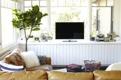 Bright and airy family room makeover - Emily Henderson windows on 3 sides, paneling, wood floor, beams on the ceiling, light and bright – family room Tan Leather Sofas, Leather Sectional, Cozy Family Rooms, Types Of Sofas, Pretty Room, People Magazine, Living Room Inspiration, Living Spaces, Living Rooms