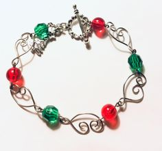 Red and Green Bead Christmas Bracelet with silver Wire links, closes with a round toggle clasp, and has a Christmas tree charm. Valentines Jewelry, Christmas Jewelry, Metal Jewelry, Unique Jewelry, Jewelry Findings, Jewelry Ideas, Jewlery, Silver Bracelets, Jewelry Making