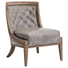 A perfect reading nook essential, the Alistair Tifton occasional chair provides a graceful presence. The curved back and splayed legs lend a playful edge to this modern seat, while button-tufted top grain leather presents stunning textural allure. The light gray hue offers airy versatility to an array of styles and decor. 26in W x 31.75in D x 33.25in H. Rubberwood and top grain leather.